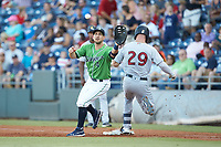Gwinnett Stripers first baseman Sean Kazmar Jr. (4) reaches for a throw as Trey Amburgey (29) of the Scranton/Wilkes-Barre RailRiders steps on first base at Coolray Field on August 16, 2019 in Lawrenceville, Georgia. The Stripers defeated the RailRiders 5-2. (Brian Westerholt/Four Seam Images)