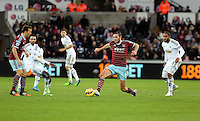 Pictured: Andy Carroll of West Ham (C), Nathan Dyer of Swansea (2nd L) and Ashley Williams (R) Saturday 10 January 2015<br /> Re: Barclays Premier League, Swansea City FC v West Ham United at the Liberty Stadium, south Wales, UK
