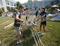 Emery Brandt (left) and Paloma Rosso, both ninth-graders at Thaden School in Bentonville, assemble a bamboo star Friday, Sept. 10, 2021, during the University of Arkansas Honors College Math Circus at Gearhart Hall on the university campus in Fayetteville. The event offered visitors a chance to build mathematical structures and to decorate with mathematical designs as a part of the larger celebration of the university's 150th birthday, Visit nwaonline.com/210911Daily/ for today's photo gallery.<br /> (NWA Democrat-Gazette/Andy Shupe)
