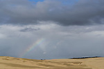 Storm and Rainbow on the sand dunes. Stockton Beach Sand dunes Worimi Conservation Lands. Anna Bay, Port Stephens, NSW, Australia