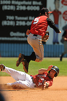 Daniel Wagner #5 Second Baseman  Kannapolis Intimidators (White Sox) leaps to avoid being taken out  by a hard sliding Avery Barnes Asheville Tourists (Rockies)vMay 23, 2010 Photo By Tony Farlow/Four Seam Images.