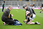 Tony Kelly of Ballyea changes his boots  before the All-Ireland Club Hurling Final against Cuala at Croke Park. Photograph by John Kelly.