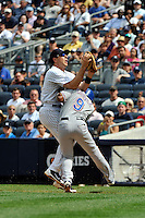 New York Yankees infielder Mark Teixeira #25 catches pop up while Texas Rangers hitter Endy Chavez #9 runs into Teixeira during game played at Yankee Stadium on June 16, 2011 in Bronx, NY.  Yankees defeated Rangers 3-2.  Tomasso DeRosa/Four Seam Images