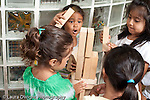 Education Preschool 3-5 year olds block area group of girls building with wooden blocks horizontal