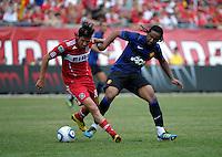 Chicago Fire midfielder Sebastian Grazzini (10) is pressured by Manchester United midfielder Anderson (8).  Manchester United defeated the Chicago Fire 3-1 at Soldier Field in Chicago, IL on July 23, 2011.