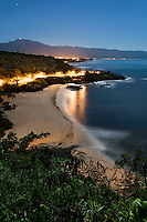 An aerial night view of Waimea Bay, North Shore, O'ahu.