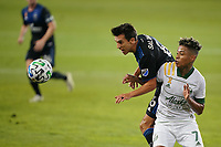 SAN JOSE, CA - SEPTEMBER 16: Shea Salinas #6 of the San Jose Earthquakes battles for the ball with Andy Polo #7 of the Portland Timbers during a game between Portland Timbers and San Jose Earthquakes at Earthquakes Stadium on September 16, 2020 in San Jose, California.