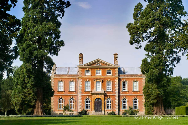 Kingston Bagpuize House in Oxfordshire, UK. Western elevation of Kingston Bagpuize House, Kingston Bagpuize, Oxfordshire. The present house was built in the early 18th century on the site of a 16th century manor house although the earliest records of the estate date back to the De Bachepuis family who were lords of the manor from the 11th century. The house has associations with the novelist John Buchan, Lord Tweedsmuir who is believed to have made it his home in the early 20th Century.