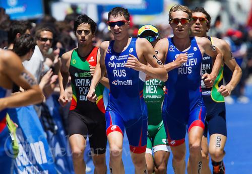 02 JUN 2013 - MADRID, ESP - Dmitry Polyanskiy (RUS) (second from the left in blue) and Denis Vasiliev (RUS) (second from the right in blue) of Russia during the run at the men's ITU 2013 World Triathlon Series round in Casa de Campo, Madrid, Spain <br /> (PHOTO (C) 2013 NIGEL FARROW)