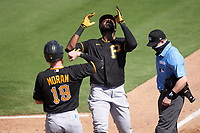 Pittsburgh Pirates Gregory Polanco (25) points to the sky after hitting a home run as Colin Moran (19) greets him at home during a Major League Spring Training game against the Baltimore Orioles on February 28, 2021 at Ed Smith Stadium in Sarasota, Florida.  (Mike Janes/Four Seam Images)