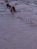 CIHILDREN PLAYING IN MUDDY WATER