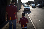 Bradford City 3, Carlisle United 1, 21/09/2019. Valley Parade, EFL League 2. A man and boy heading away from the ground after Bradford City played Carlisle United in a Skybet League 2 fixture at Valley Parade. The home team were looking to bounce back after being relegated during a disastrous 2018-19 season on and off the pitch. Bradford won the match 3-1, watched by a crowd of 14, 217. Photo by Colin McPherson.