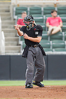 Home plate umpire George Reidel makes a strike call during the South Atlantic League game between the Savannah Sand Gnats and the Kannapolis Intimidators at CMC-Northeast Stadium on June 9, 2014 in Kannapolis, North Carolina.  The Intimidators defeated the Sand Gnats 4-2.  (Brian Westerholt/Four Seam Images)