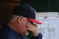 OAKLAND, CA - JULY 30:  Manager Ron Gardenhire #35 of the Minnesota Twins wipes his eyes in the dugout during the game against the Oakland Athletics at the Oakland-Alameda County Coliseum on July 30, 2011 in Oakland, California. Photo by Brad Mangin