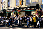 Duke of Wellington pub, Elgin Cresent, off Portobello Road, Notting Hill, London. Crowds of Saturday lunch time drinkers on the pavement. 1990s  1999.<br /> <br /> Duke of Wellington pub Elgin Crescent Notting Hill 1990s UK