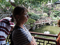 Isabelle at one of the ponds in Yu Gardens.  Yu Gardens, a peaceful place to escape the bustle of Shanghai.  Full of visitors, still very calming.  Details in the buildings, doors and stone sculptures.  Helps get your Ying and Yang in balance.