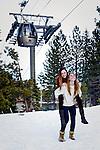 Girlfriends having fun in the snow
