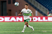 FOXBOROUGH, MA - AUGUST 26: Noah Pilato #20 of Greenville Triumph SC attempts to control the ball during a game between Greenville Triumph SC and New England Revolution II at Gillette Stadium on August 26, 2020 in Foxborough, Massachusetts.