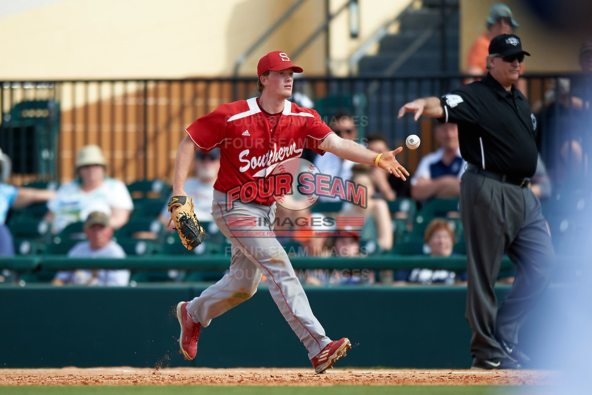 Florida Southern Moccasins first baseman Sam Machonis (32) flips the ball to the pitcher covering during an exhibition game against the Detroit Tigers on February 29, 2016 at Joker Marchant Stadium in Lakeland, Florida.  Detroit defeated Florida Southern 7-2.  (Mike Janes/Four Seam Images)