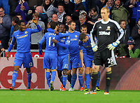 Saturday, 03 November 2012<br /> Pictured: Victor Moses of Chelsea (C) celebrating the opening goal with team mates while Swansea goalkeeper Gerhard Tremmel (R) looks dejected.<br /> Re: Barclays Premier League, Swansea City FC v Chelsea at the Liberty Stadium, south Wales.