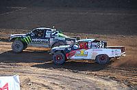 Dec. 10, 2011; Chandler, AZ, USA;  LOORRS pro lite unlimited driver Casey Currie (2) and Chris Brandt (82) during round 15 at Firebird International Raceway. Mandatory Credit: Mark J. Rebilas-