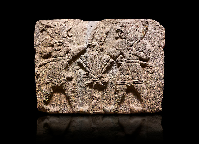 Aslantepe Hittite relief sculpted orthostat stone panel of Lion Men. Limestone, 1399-1301 BC. Anatolian Civilizations Museum, Ankara, Turkey.<br /> <br /> There are two lion-men with a sword at their waists on both sides of the tree of life. The figure on the right holds a sickle in his left hand resting on his shoulder and a symbol his right hand. The figure on the left carries a double-faced ax in his right hand.