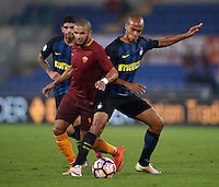 Calcio, Serie A: Roma vs Inter. Roma, stadio Olimpico, 2 ottobre 2016.<br /> Roma's Bruno Peres, left, and FC Inter's Joao Mario fight for the ball during the Italian Serie A football match between Roma and FC Inter at Rome's Olympic stadium, 2 October 2016.<br /> UPDATE IMAGES PRESS/Isabella Bonotto