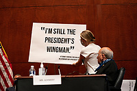 """A United States House Judiciary Committee staffer switches a sign during a hearing on """"Oversight of the Department of Justice: Political Interference and Threats to Prosecutorial Independence"""" on Capitol Hill in Washington DC on June 24th, 2020.<br /> Credit: Anna Moneymaker / Pool via CNP/AdMedia"""