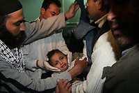 "Gaza.18.01.2008A man carries a boy who was injured after an Israeli missile strike destroyed Hamas's Interior Ministry in Gaza January 18, 2008. An Israeli missile strike destroyed Hamas's Interior Ministry in Gaza City on Friday, but the building was empty at the time, Hamas security sources and local witnesses said.<br /> .""photo by Fady Adwan"