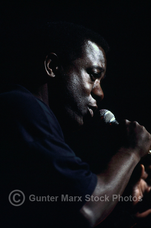 Portrait of African American Man, Black Male Singer singing with Microphone (No Model Release Available)