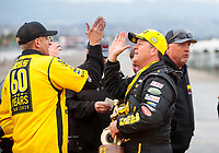 Feb 9, 2020; Pomona, CA, USA; NHRA pro stock driver Jeg Coughlin Jr celebrates with crew after winning the Winternationals at Auto Club Raceway at Pomona. Mandatory Credit: Mark J. Rebilas-USA TODAY Sports
