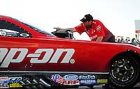 Sept. 23, 2011; Ennis, TX, USA: NHRA crew member for funny car driver Cruz Pedregon during qualifying for the Fall Nationals at the Texas Motorplex. Mandatory Credit: Mark J. Rebilas-