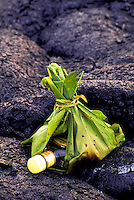 A bottle of gin pokes through an opening in the ti-leaf bundle offering to Pele, the volcano goddess at Volcanoes National Park on the Big Island of Hawaii.