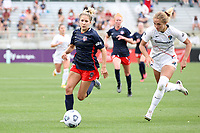 CARY, NC - APRIL 10: Ashley Sanchez #10 of the Washington Spirit is challenged for the ball by Schuyler Debree #15 of the North Carolina Courage during a game between Washington Spirit and North Carolina Courage at Sahlen's Stadium at WakeMed Soccer Park on April 10, 2021 in Cary, North Carolina.