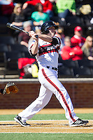 Justin Glass (16) of the Cincinnati Bearcats follows through on his swing against the Radford Highlanders at Wake Forest Baseball Park on February 22, 2014 in Winston-Salem, North Carolina.  The Highlanders defeated the Bearcats 6-5.  (Brian Westerholt/Four Seam Images)
