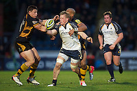 Jake Abbott of Worcester Warriors is tackled by Tom Lindsay (left) and Tom Varndell of London Wasps during the LV= Cup second round match between London Wasps and Worcester Warriors at Adams Park on Sunday 18th November 2012 (Photo by Rob Munro)