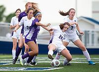 Jayden Tyler (12) of Fayetteville and Eliza Lewis (26) of Mount Saint Mary's Academy fight for ball near goal at Wildcat Stadium, Springdale, Arkansas, Friday, May 14, 2021 / Special to NWA Democrat-Gazette/ David Beach