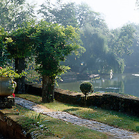 In this magical garden moss-covered walls and an ancient stone pergola frame a tranquil view across the lake