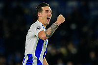 Lewis Dunk of Brighton & Hove Albion (5) celebrates the  3-1 win with a fist punch to the fans ,during the Premier League match between Brighton and Hove Albion and Crystal Palace at the American Express Community Stadium, Brighton and Hove, England on 4 December 2018. Photo by Edward Thomas / PRiME Media Images.