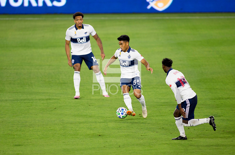 LOS ANGELES, CA - SEPTEMBER 23: Michael Baldisimo #55 of the Vancouver Whitecaps moves with the ball during a game between Vancouver Whitecaps and Los Angeles FC at Banc of California Stadium on September 23, 2020 in Los Angeles, California.