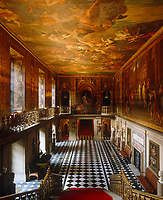 A view down the stairs to the Painted Hall, which features the work of Louis Laguerre depicting the life of Julius Caesar, 1692-4