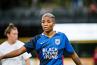 TACOMA, WA - JULY 31: Tziarra King #23 of the OL Reign looks on during a game between Racing Louisville FC and OL Reign at Cheney Stadium on July 31, 2021 in Tacoma, Washington.