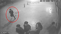BNPS.co.uk (01202) 558833. <br /> Video: BNPS<br /> <br /> With Video - NEW Download Link: https://we.tl/t-jFBHCA9sRz<br /> <br /> Pictured: The attacker, circled, comes back into the frame with his rucksack in hand. <br /> <br /> <br /> This is the shocking moment a thug viciously swings a lethal machete at a young man in the centre of Britain's most popular tourist resort that is packed with holidaymakers.<br /> <br /> The assailant produces the 18ins blade from out of his rucksack, holds it above his head and then swings it at his rival.<br /> <br /> It was only because the victim was agile enough to dodge out of the way of the weapon that he wasn't struck by it.<br /> <br /> CCTV footage shows him then run away while pursued by a pack of eight would be attackers in Bournemouth.