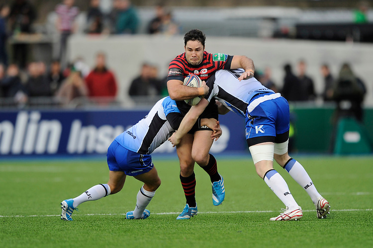 Brad Barritt of Saracens is tackled during the Heineken Cup Round 6 match between Saracens and Connacht Rugby at Allianz Park on Saturday 18th January 2014 (Photo by Rob Munro)