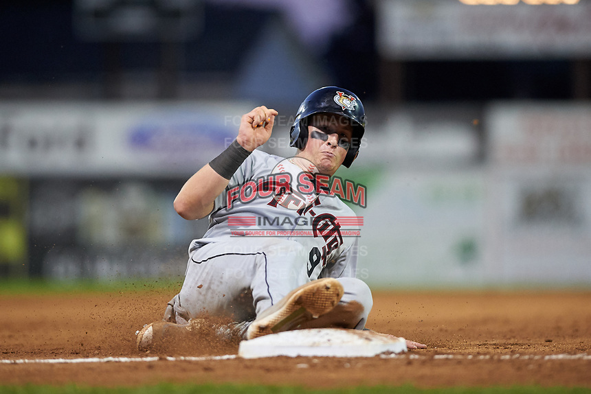 Tri-City ValleyCats catcher Michael Papierski (9) slides into third base during a game against the Batavia Muckdogs on July 15, 2017 at Dwyer Stadium in Batavia, New York.  Tri-City defeated Batavia 5-4.  (Mike Janes/Four Seam Images)
