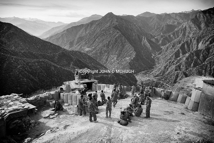 Afghan National Army soldiers are seen at Observation Post Mace, near Gowerdesh in northern Kunar, 22 November 2011. (John D McHugh)