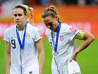 Heather O'Reilly (l) and Christie Rampone of team USA react during the FIFA Women's World Cup Final USA against Japan at the FIFA Stadium in Frankfurt, Germany on July 17th, 2011.