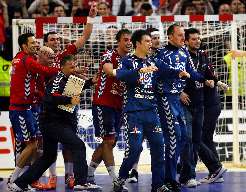 Serbian players celebrate victory after men`s EHF EURO 2012 championship semifinal handball game against Croatia in Belgrade, Serbia, Friday, January 27, 2011.  (photo: Pedja Milosavljevic / thepedja@gmail.com / +381641260959)