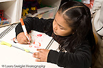 Education preschoool children ages 3-5 art activity horizontal girl drawing with marker writing letters recognizable human figure horizontal