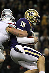 Jake Locker (#10), University of Washington quarterback, feels the pain of a hit by Andy Mattingly (#45) during the Huskies Pac-10 conference football game against arch-rival Washington State at Husky Stadium in Seattle, Washington, on November 28, 2009.  Washington shut out the Cougars in their annual Apple Cup battle, 30-0.